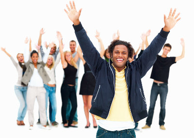 Group of happy friends standing against white background and raising hands